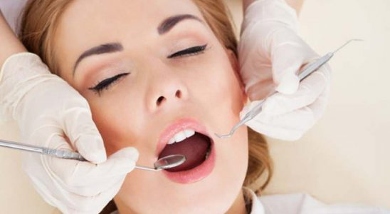 Woman Having Dental Checkup